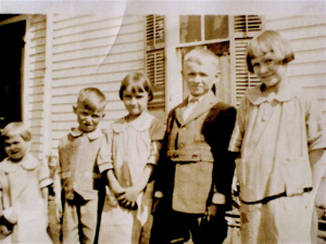 A picture of Grandma's five children, lined up in a row on the farm.  My mother is the middle child.